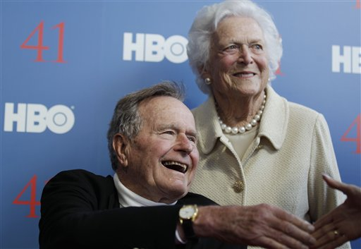 "FILE - In a Tuesday, June 12, 2012 file photo, former President George H.W. Bush, and his wife, former first lady Barbara Bush, arrive for the premiere of HBO's new documentary on his life near the family compound in Kennebunkport, Maine. Bush spokesman Jim McGrath said Wednesday, Dec. 26. 2012 that doctors at the Houston hospital where Bush has been treated for a month remain ""cautiously optimistic"" that he will recover. Still, no discharge date has been set, and McGrath says that doctors are being cautious because at Bush's age ""sometimes issues crop up that are beyond anybody's ability to discern or foretell."" (AP Photo/Charles Krupa, File)"