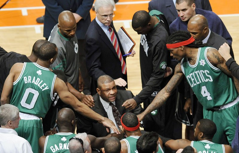 LET'S START LATER: The Boston Celtics gather around coach Doc Rivers during the first quarter of their game against the New York Knicks last Christmas at Madison Square Garden in New York. The league started late last season out of necessity following the lockout, but Rivers and others think it's something the NBA should consider doing regularly, to create more anticipation and separate itself further from the football season.