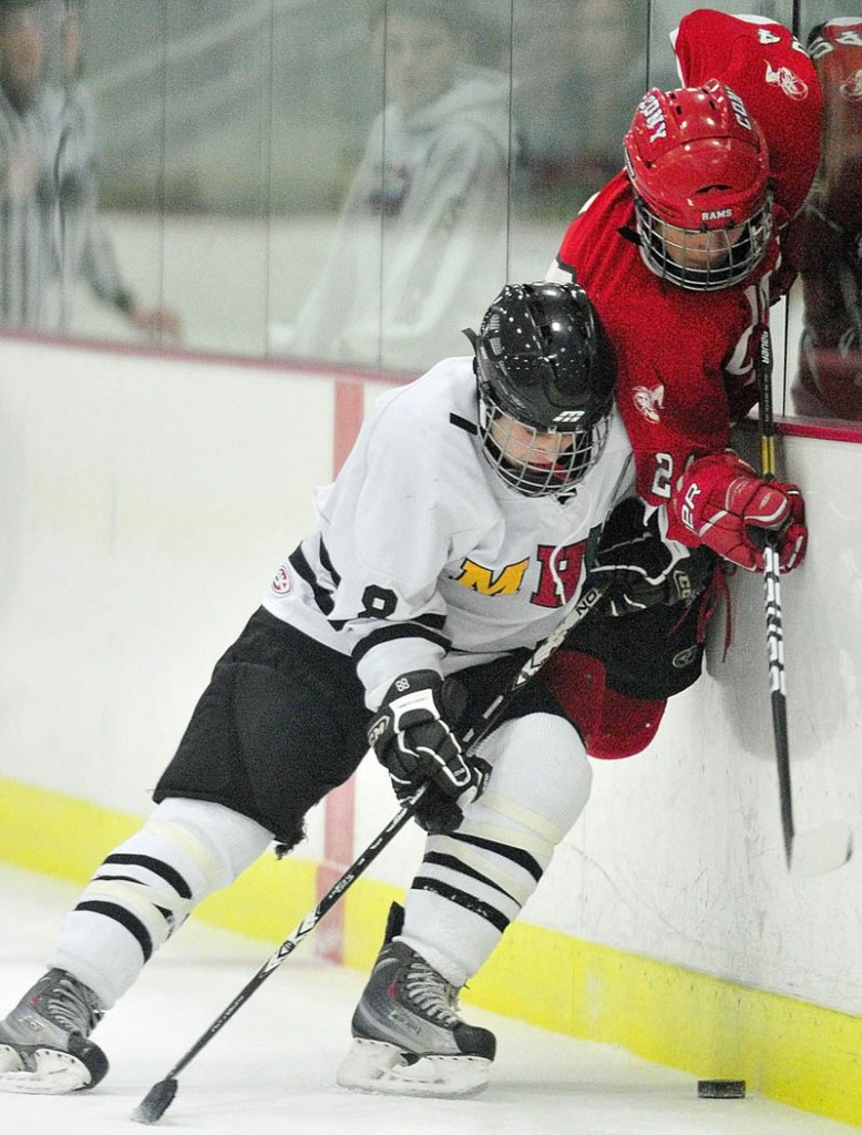 BATTLE FOR THE PUCK: MHW's Wes Boynton, left, and Cony's Anthony Brunelle fight for the buck against the boards during the Rams' 7-5 win Wednesday at the Bonnefond Ice Arena at Kents Hill School in Readfield.