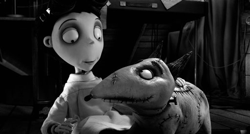 "This film image released by Disney shows Victor Frankenstein, voiced by Charlie Tahan, with Sparky, in a scene from ""Frankenweenie."" The film was nominated for a Golden Globe for best animated film on Thursday, Dec. 13, 2012. The 70th annual Golden Globe Awards will be held on Jan. 13. (AP Photo/Disney) frankenweenie;tim burton;disney;victor;sparky;stop motion;animation"