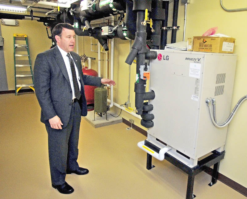 Executive Vice President Andrew E. Silsby talks about the heat pump system during a tour of the new Kennebec Savings Bank branch, at the corner of Main and Northern Avenues in Farmingdale, on Wednesday.