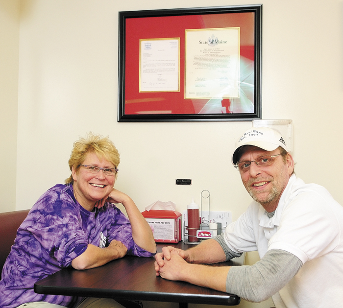 Laura Benedict, left, and Peter Benedict, sister and brother co-owners of The Red Barn, pose in the restaurant on Dec. 4, in Augusta.