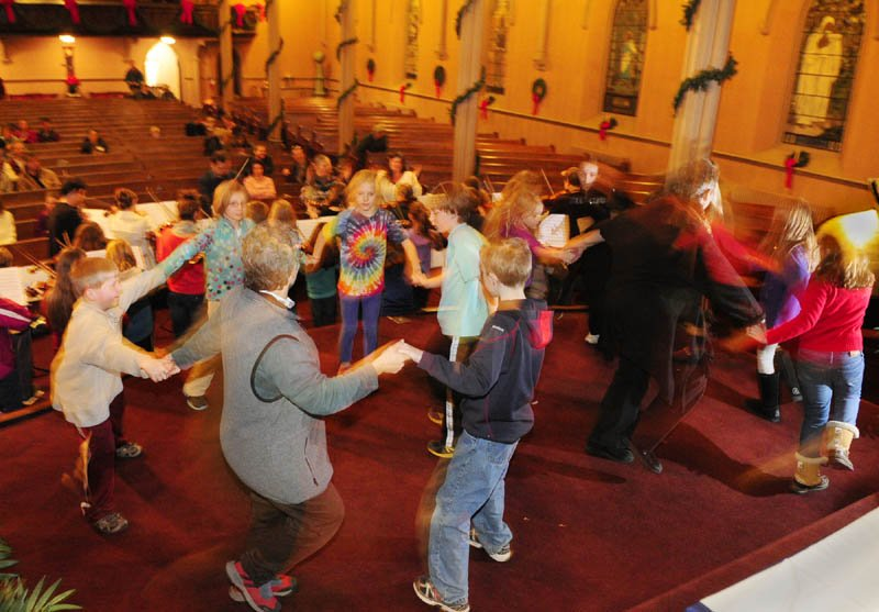 """The Pineland Suzuki School rehearses on Friday night at South Parish Congregational Church in Augusta. Their concert will feature singers and dancers, along with the orchestra for a """"Lord of The Dance"""" number."""