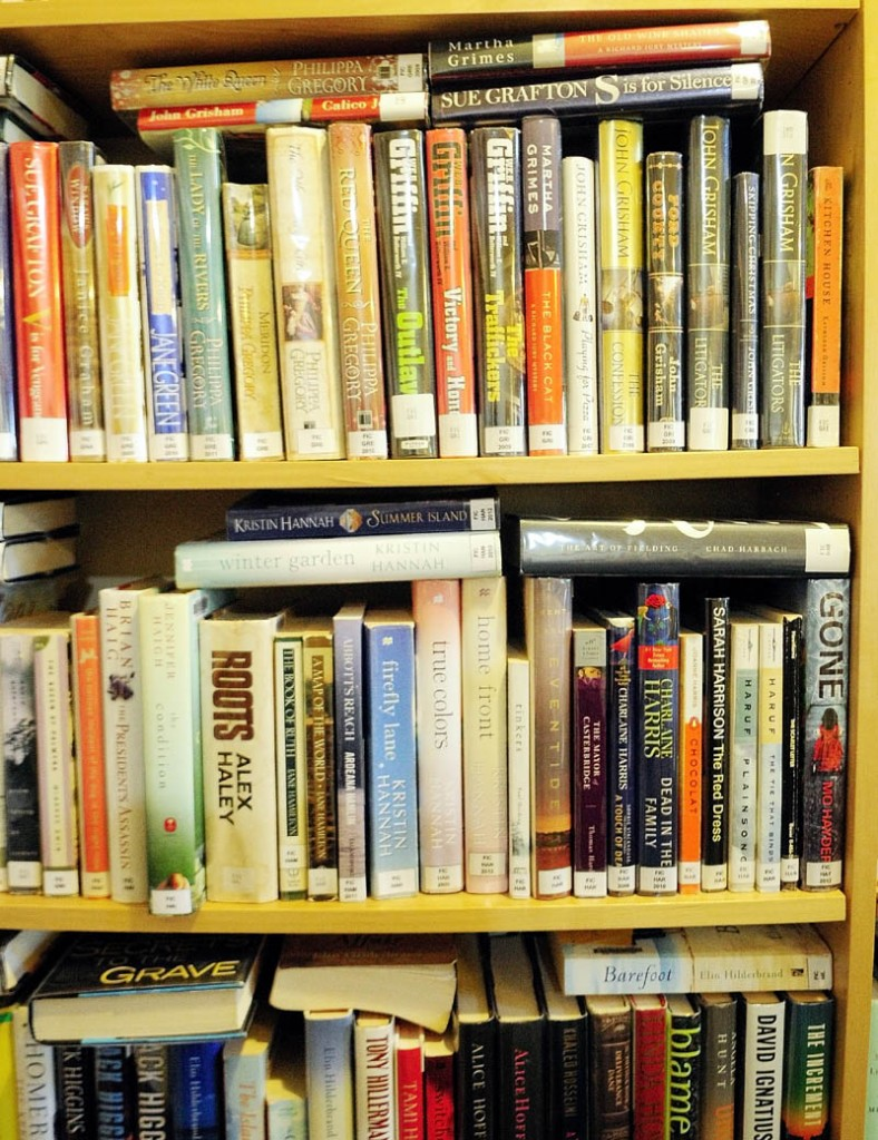 Books are horizontally stacked to fit more in the shelves, on Thursday at the Belgrade library.