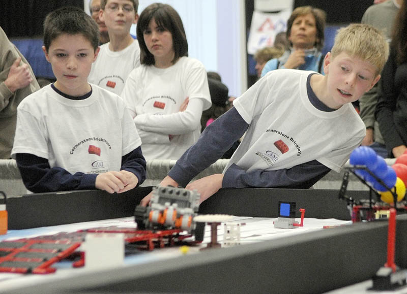 Preston Moody, left, and Isaac Lawrence, from the Cornerstone Community Church team in Winthrop, watch their team' s robot compete at the 13th annual Maine First LEGO League Championship on Saturday, at the Augusta Civic Center.