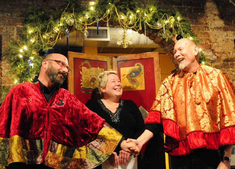 """Brian Kaufman, left, and Martin Swinger, right, sing """"Stuck On You,"""" from the musical """"Whoop-Dee-Doo!,"""" to each other during their wedding on Saturday at Slates Restaurant in Hallowell. Their wedding was officiated by Hallowell Mayor Charlotte Warren, center."""