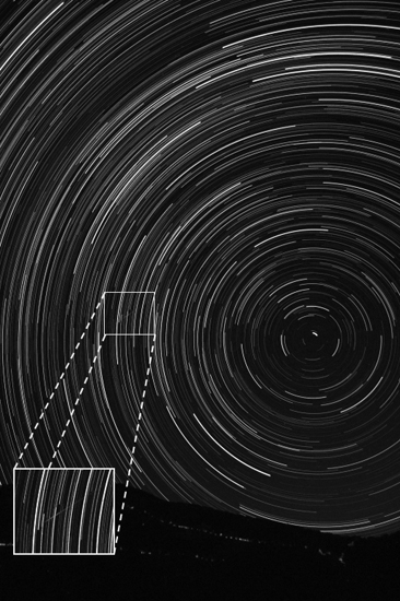A 2 1/2-hour time lapse photo made Aug. 12, 2008, in Greece shows the stars circling around the pole star Polaris with a Perseid meteor (inset).