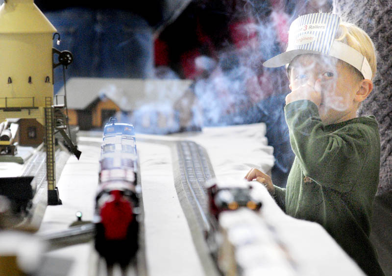 Jaden Desmarais, 7 of Searsport, doesn't like the smell of the smoke coming off a model train running through a display on Friday at the Maine State Museum in Augusta.