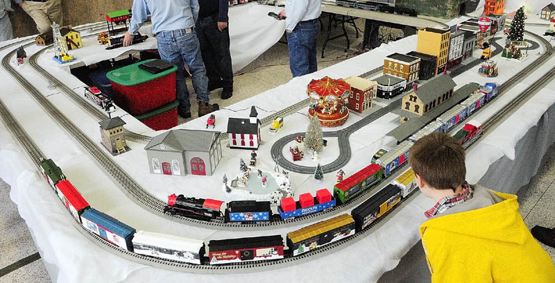 Justin Widen, 10 of Wilton, takes a closer look at the model railroad displays on Friday at the Maine State Museum in Augusta.