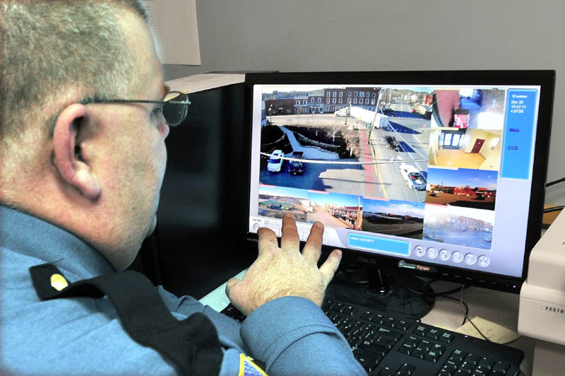 Skowhegan Interim Police Chief Dan Summers looks at eight different live videos taken from surveillance cameras placed in downtown Skowhegan, on Thursday.