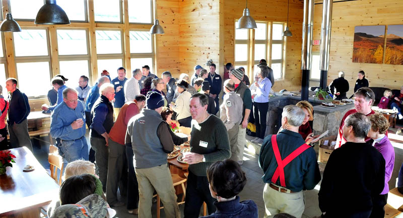 The new Stratton Brook Hut, the fourth building in the Maine Huts and Trails system, is full with organization members, supporters, and contributors during an official opening of the hut in Carrabassett Valley on Wednesday.