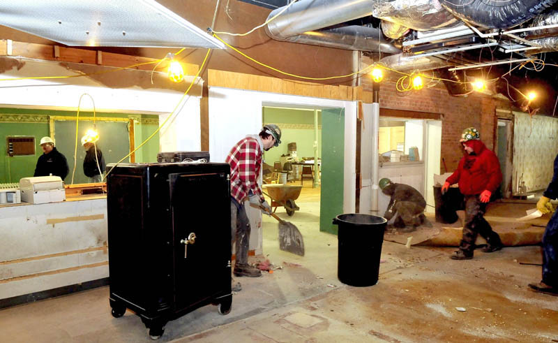 Sheridan Construction workers remove carpet, tile, electrical fixtures and molding from the office area in the former Gerald Hotel in Fairfield on Thursday. The building will be turned into senior housing.