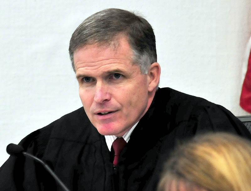 Justice John Nivison addresses the court prior to announcing his decision that Robert Nelson is guilty in the death of Everett L. Cameron in Somerset County Superior Court in Skowhegan on Tuesday, Dec. 18, 2012.