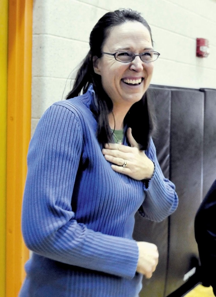 "Staff photo by David Leaming REACT: Skowhegan Area Middle School teacher Margaret Pietrak reacts with surprise and joy after it was announced that her science class was awarded a $1,000 check from S.W. Cole Engineering Inc. as winners in the company's annual ""Dig Into Science"" contest on Thursday, Dec. 13, 2012."