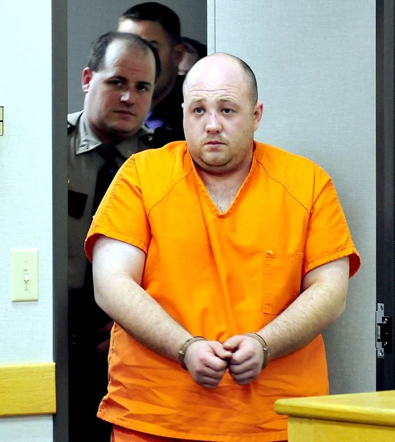 Matthew Partridge, of Winslow, is led into District Court in Waterville on Wednesday for an initial appearance in the shooting death of Justin Smith, of China, n Waterville late Tuesday evening.