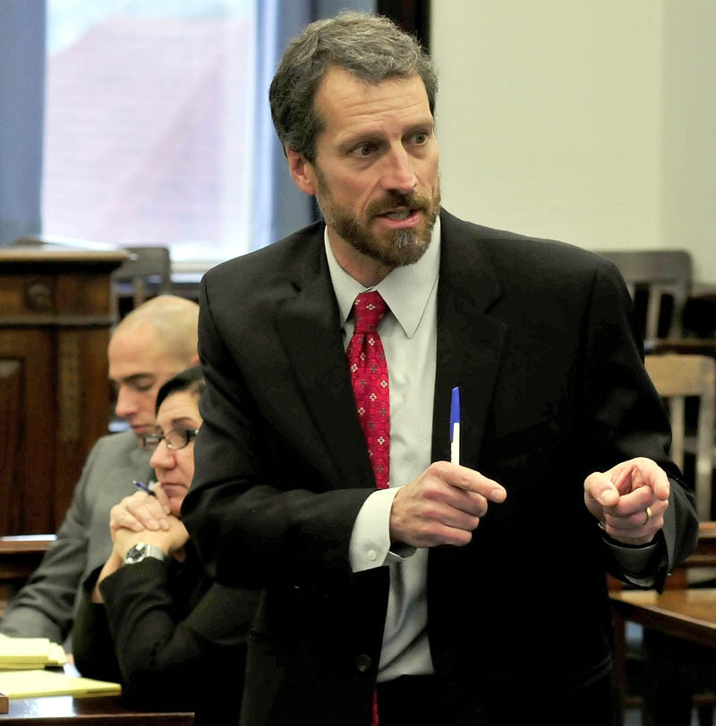Defense attorney Phil Mohlar makes a point during his closing arguments during the Robert Nelson murder trial in Somerset County Superior Court in Skowhegan on Tuesday. At the immediate left is state prosecutor Leane Zainea.