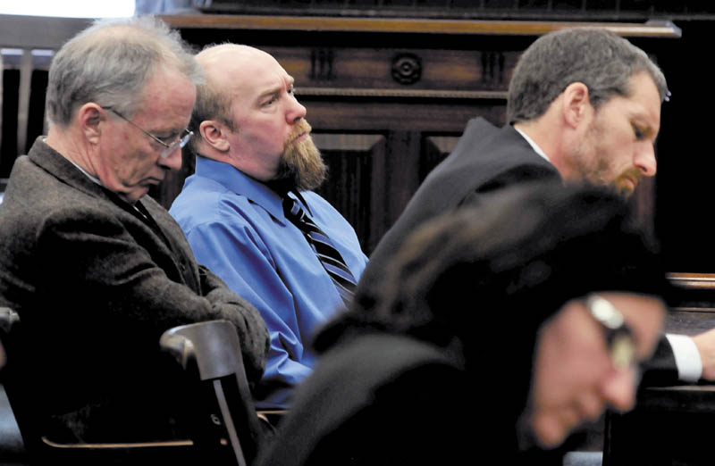 GUILTY: Murder defendant Robert Nelson, center, is flanked by his attorneys John Alsop, left, and Phil Mohlar before it was announced that he is guilty in the death of Everett L. Cameron in Somerset County Superior Court in Skowhegan on Tuesday, Dec. 18, 2012. State prosecutor Leane Zainea is in foreground.