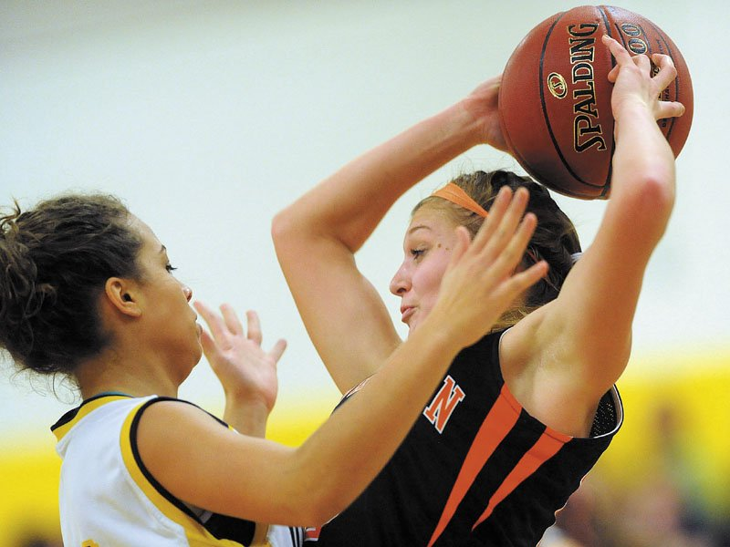 Mt. Blue High School's Kayla Newbill, 31, pressures Skowhegan High School's Adriana Martineau, 23, right, in the first quarter at Mt. Blue High School in Farmington.