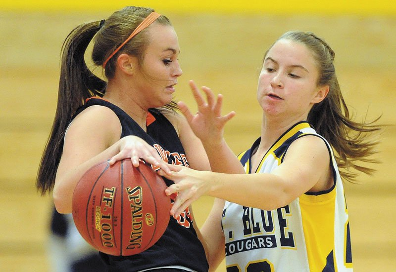 TOUGH D: Mt. Blue High School's Mackenzie Conlogue, right, pressures Skowhegan High School's Desiree Brochu, left, in the second quarter Friday in Farmington.