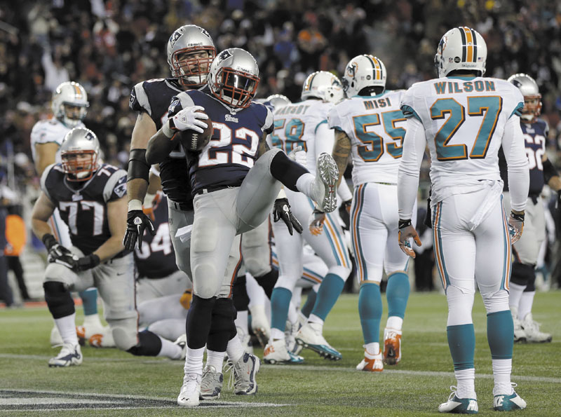 LET'S CELEBRATE: New England Patriots running back Stevan Ridley (22) celebrates his second touchdown against the Miami Dolphins during the second quarter Sunday in Foxborough, Mass. Gillette Stadium