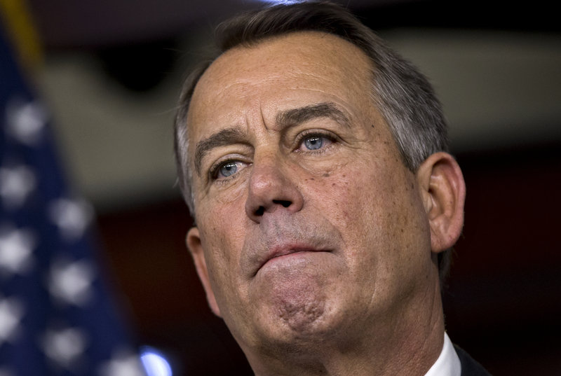 Speaker of the House John Boehner, R-Ohio, speaks to reporters about the fiscal cliff negotiations at the Capitol in Washington, Friday, Dec. 21, 2012. Five deays from the U.S. going over the 'fiscal cliff,' there's no deal in sight. (AP Photo/J. Scott Applewhite)