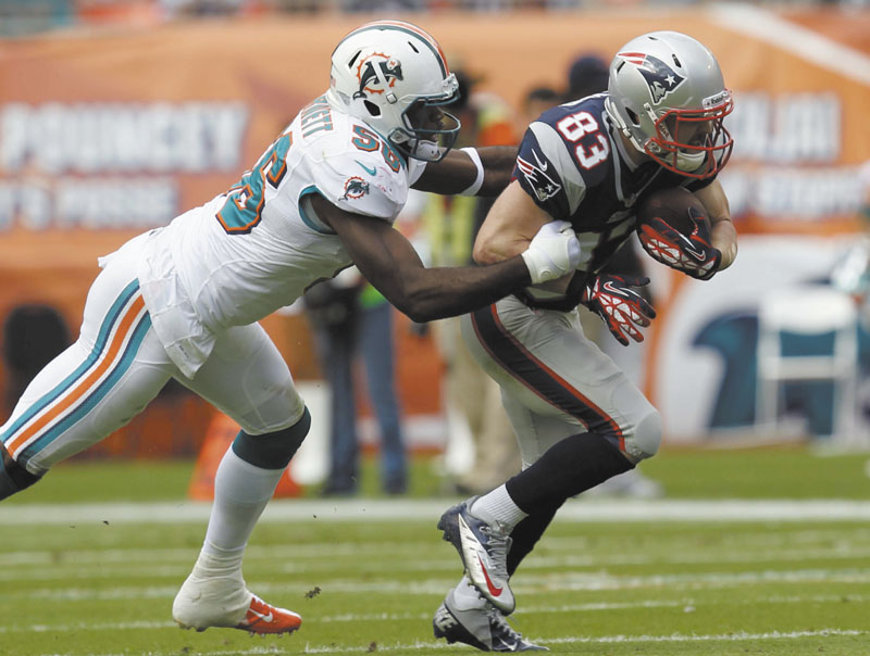 GETTING IT DONE: Wide receiver Wes Welker, right, got off to a slow start this season, but now leads the NFL with 92 catches. He'll have to play a bigger role in the Patriots' offense with Rob Gronkowski and Julian Edelman sidelined by injuries.