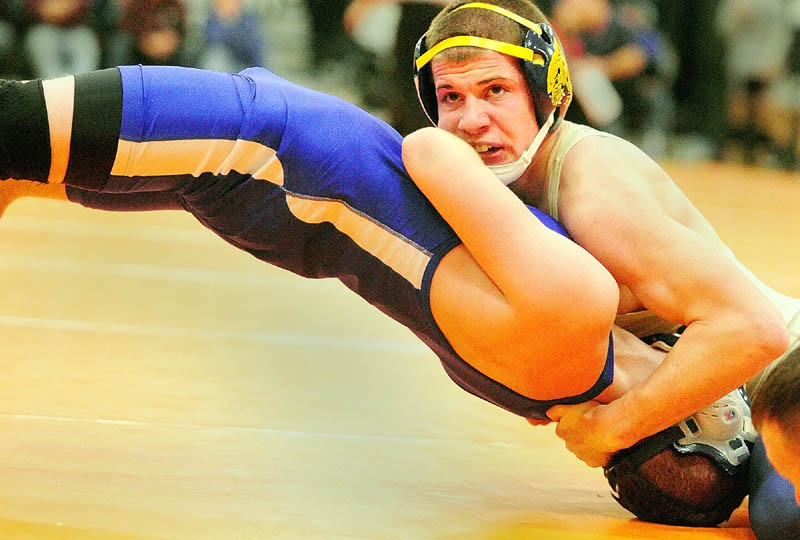 Staff photo by Joe Phelan BRIDGE: Mt. Blue's Kevin Moore, top right, works on pinning Erskine Academy's Joe York on way to winning the 132-pound championship match of the Tiger Invitational on Saturday in the James A. Bragoli Memorial Gym in Gardiner.