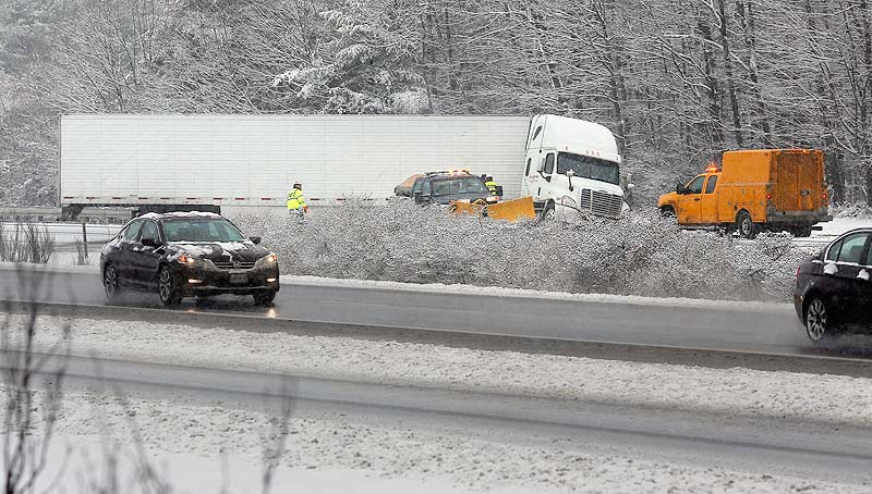 A tractor-trailer jackknifed across I-295 southbound just past Exit 17 in Yarmouth on Wednesday as a winter storm caused slippery roads throughout Maine.