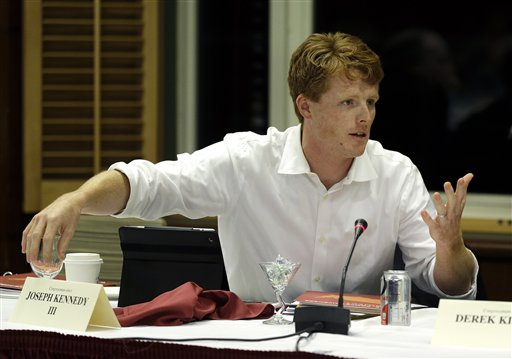 """Newly elected U.S. Representative Joseph Kennedy III, D-Mass, asks a question during a panel discussion entitled """"The Looming Challenge to U.S. Competitiveness"""" at Harvard University's Institute of Politics in Cambridge, Mass., Thursday, Dec. 13, 2012. (AP Photo/Elise Amendola)"""