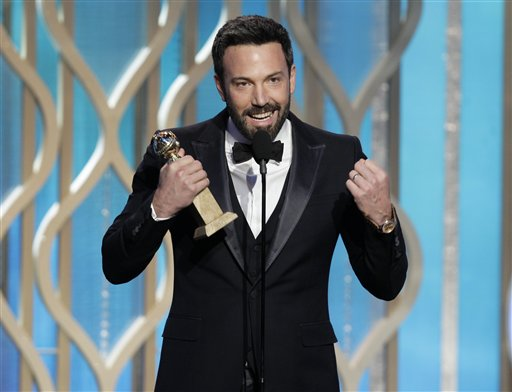 "Ben Affleck holds his award for best director for ""Argo"" at the Golden Globe Awards in Beverly Hills, Calif., on Sunday. ""Argo"" also bested fellow best-drama nominee ""Lincoln"" at the Globes. 2010s,2013,Air Date 01/13/2013,Awards Show,Color,Event,Indoors,NUP_154609,Season 70,select"