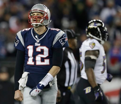 New England Patriots quarterback Tom Brady looks up at the scoreboard during the second half of Sunday's AFC Championship game against the Baltimore Ravens.