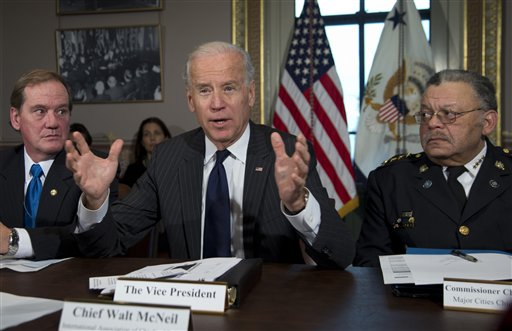 Vice President Joe Biden, flanked by Thomas Nee, left, the president of the National Association of Police Organizations and a Boston police officer, and Charles Ramsey, president of the Police Executive Research Forum and Major Cities Chiefs Association and Philadelphia police commissioner, speaks during a meeting in Washington on Dec. 20, 2012.