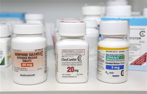 In this photo taken Friday, morphine sulfate, OxyContin and Opana are displayed for a photograph in Carmichael, Calif. Maine's best-in-the-nation record of turning in unwanted prescription medications for destruction is threatened by new U.S. Drug Enforcement Agency rules, which limit data collection on disposed drugs and how such drugs can be destroyed.