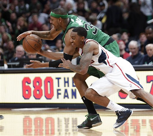 Atlanta Hawks guard Jeff Teague steals the ball from Boston Celtics forward Paul Pierce (34) during the second half of an NBA basketball game Friday, Jan. 25, 2013, in Atlanta. Atlanta won 123-111 in double-overtime. (AP Photo/John Bazemore)