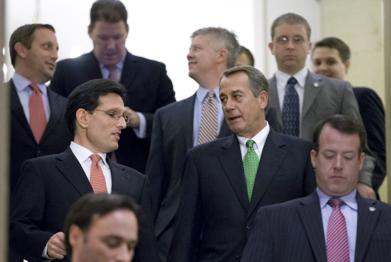 """Speaker of the House John Boehner, R-Ohio, center right, and House Majority Leader Eric Cantor, R-Va., center left, walk down stairs to a second Republican conference meeting to discuss the """"fiscal cliff"""" bill, which was passed by the Senate Monday night, at the Capitol in Washington on Tuesday."""
