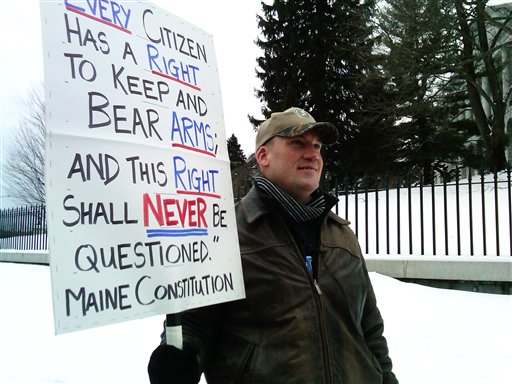 Michael Hein, of Augusta, holds a sign in front of the Maine State House during a Gun Appreciation Day rally on Saturday, Rallies were held nationwide Saturday by gun-rights advocates, four days after President Barack Obama unveiled a sweeping plan to curb gun violence.