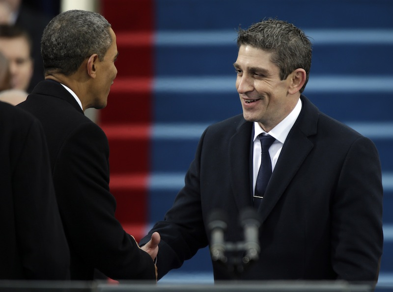 President Barack Obama, left, shakes hands with poet Richard Blanco during the ceremonial swearing-in at the U.S. Capitol during the 57th Presidential Inauguration in Washington on Jan. 21, 2013.