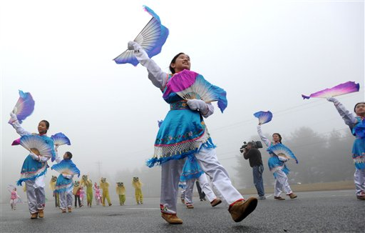"""Hali Jiang, center, practices with the Chinese American Community Center Folk Dance Troupe in """"The Dance of the Golden Snake,"""" in Hockessin, Del., on Sunday, for their performance in the presidential inauguration parade on Monday."""