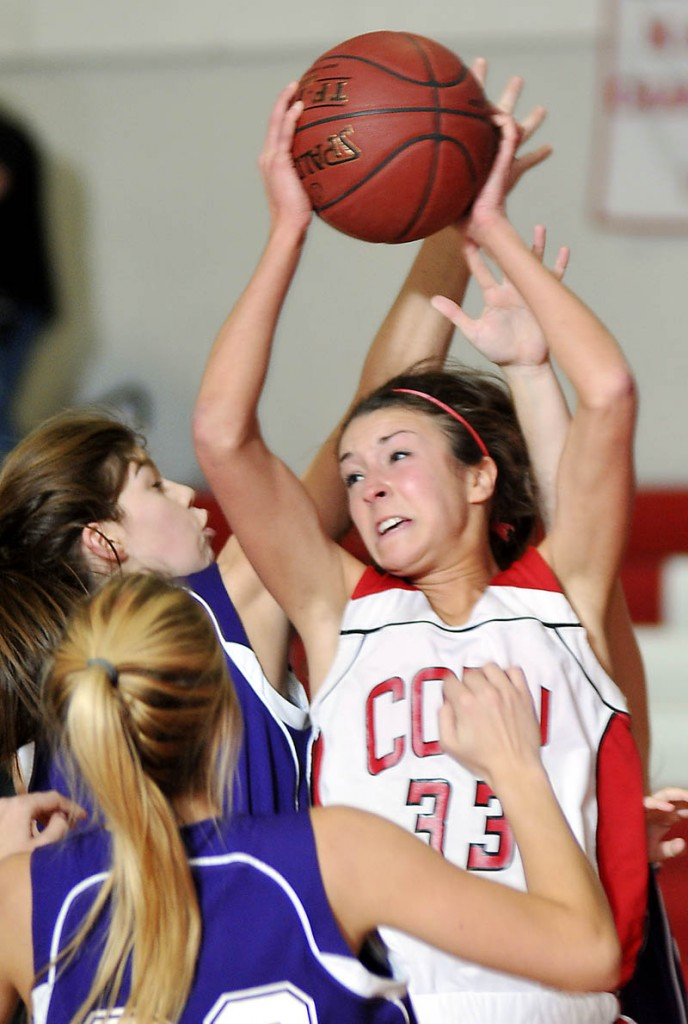 Cony High School's Josie Lee grabs a rebound against Hampden Academy on Wednesday in Augusta. Lee finished with 16 points as Cony won 57-41. For local roundup, see C3.