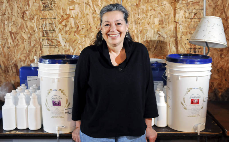 Farmingdale entrepreneur Grace Montablo is manufacturing her Gracefully Clean natural household cleaning products in the basement of her home Monday. Select Hannaford stores in Maine are stocking the products.