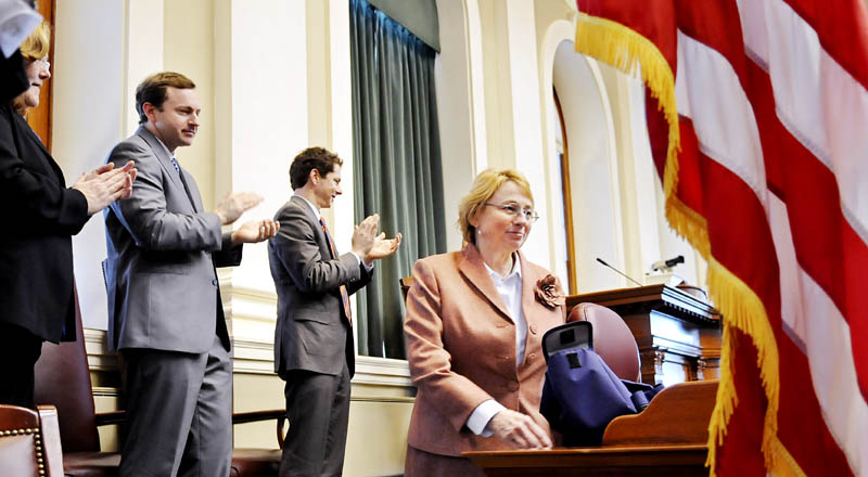 Attorney General Janet Mills is applauded by Senate President Justin Alfond, second from right, Speaker of the House Mark Eves and Supreme Court Chief Justice Leigh Saufley on Monday at the House chamber in Augusta, after Mills was sworn into the office of as Maine's top law enforcement officer.