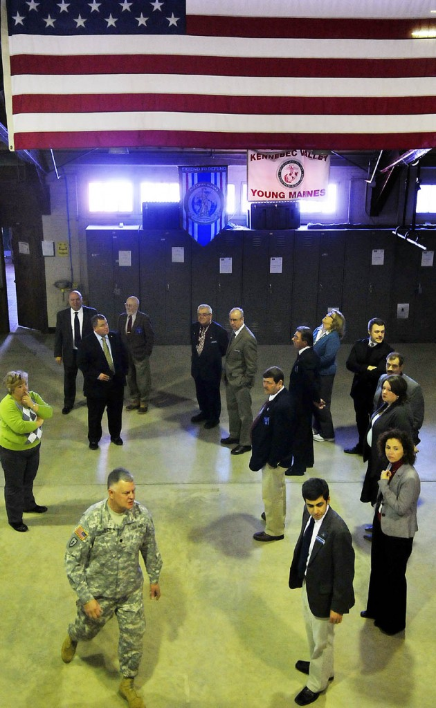 Army National Guard Lt. Col. Dwaine Drummond leads members of the Legislature's Veterans and Legal Affairs Committee on a tour Wednesday of the Gardiner armory. Soldiers with the National Guard discussed the condition of the armories across the state with the legislators.