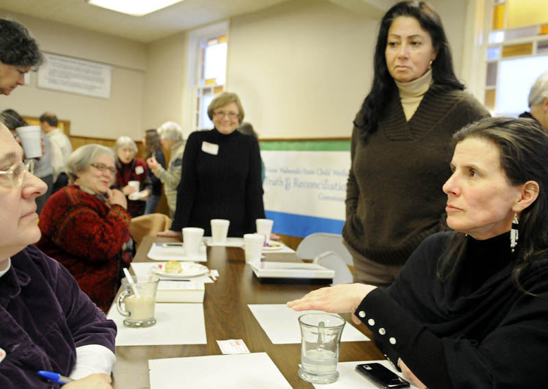 Esther Attean, right, speaks with guests at a Martin Luther King Jr. Day breakfast Monday, at the Winthrop Congregational Church, about the Maine Wabanaki-State Child Welfare Truth and Reconciliation Commission. Attean and fellow Passamaquoddy tribal member Denise Altvater, second from right, described the trauma of Native American children being placed in foster care at higher rates than white children.