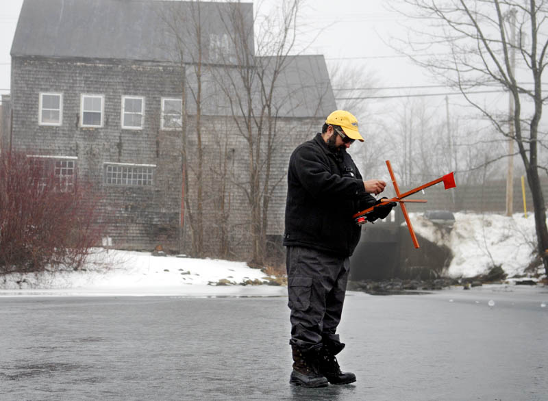 Peter Boulette, of Waterville, retrieves an ice fishing trap Sunday during an excursion on Minnehonk Lake in Mount Vernon. Boulette and his buddies, Todd Dostie and Adan Lawlor, said they encountered several flags while fishing on the ice, but only caught bass and pickerel.
