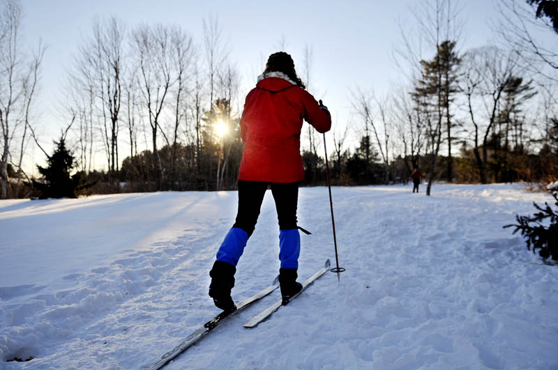 Christine Simpson, of Anchorage, Alaska, follows her husband, Eric, and mother-in-law, Karen Simpson, Wednesday while cross country skiing in Hallowell.