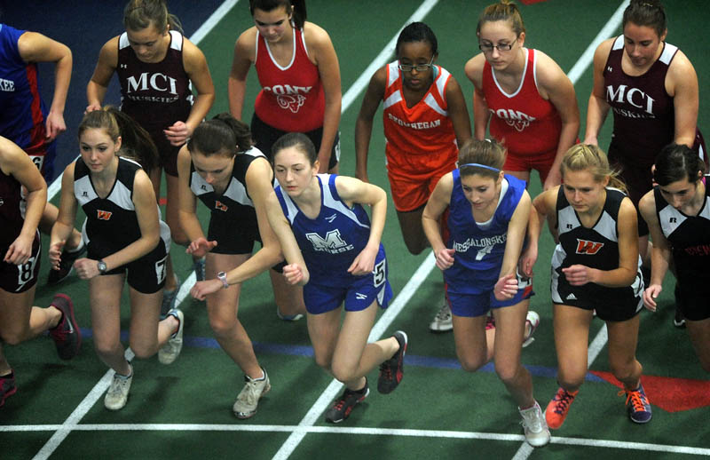 Runners competing in the girls 1-mile run leave the starting line during a high school indoor track meet at Colby College in Waterville Saturday.
