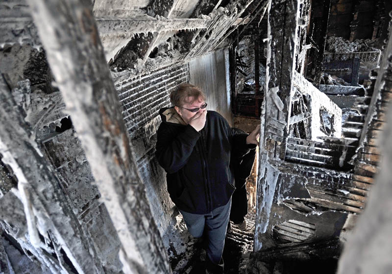 """Becky Williams, 40, becomes emotional as she looks at the second floor her parents' Madison Avenue home, which was destroyed by fire around 3 a.m. Friday. """"I can't believe no one was hurt,"""" Williams said, through her the hand over her mouth as she fought back tears."""