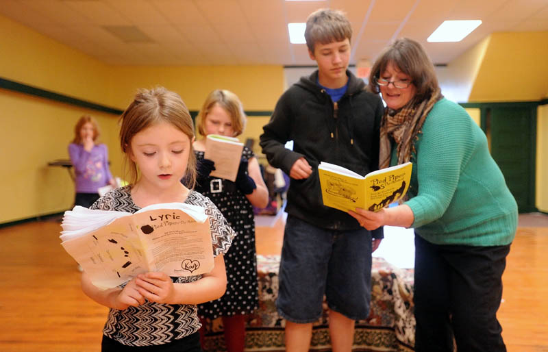 """Midge Pomelow, right, rehearses a scene from """"Pied Piper of Hamelin"""" with Cody Pomelow, 13, right center, Zoie Hills, 9, left center, and Lyric Whitaker, 6, left foreground, at Midge's Theater Arts Studio on Water Street in Skowhegan Tuesday."""