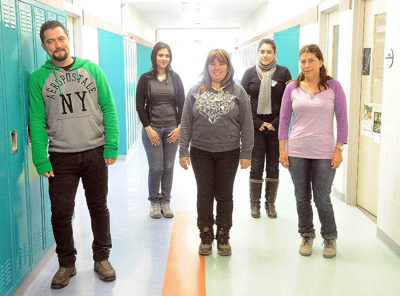 Teachers from Costa Rica toured Mt. Blue High School in Farmington Friday. They are, from left, Douglas Bolanos, 35; Laura Lopez, 31; Zileny Chaves, 45; Adriana Mesen, 22; and Xinia Vega, 50.
