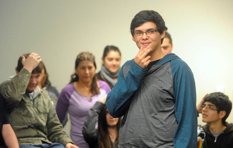 Jean Carlos Campos, 15, of Heredia, Costa Rica, plays a game with students in Spanish class at Mt. Blue High School during a visit in Farmington recently.